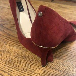 Red suede pointed toe heels